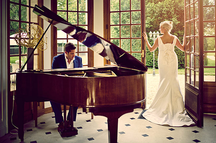 bride and groom at piano