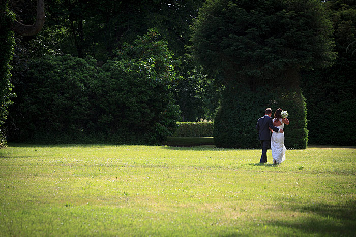 bride and groom stroll in the grounds